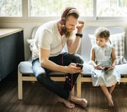Father Daughter Entertainment Family Earphone Concept stock images