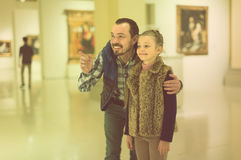 Father and daughter exploring expositions in museum Stock Photos