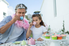Father and daughter in fairy costume having a tea party Royalty Free Stock Photo