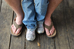 Father and daughter feet Stock Images