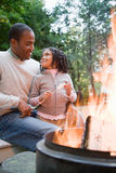 Father and daughter by fire Royalty Free Stock Image