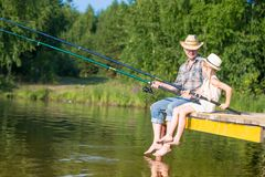 Father and daughter fishing stock photography