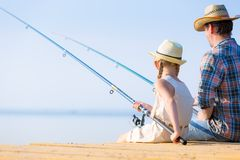 Father and daughter fishing royalty free stock images