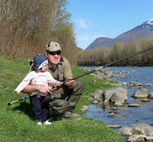 Father and daughter fishing on river Royalty Free Stock Image