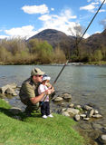 Father and daughter fishing on river Royalty Free Stock Images
