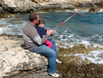 Father and daughter fishing on sea on summer day Royalty Free Stock Image