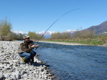 Father and daughter fishing together on the river Royalty Free Stock Image