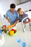 Father and daughter fixing dinner Royalty Free Stock Images