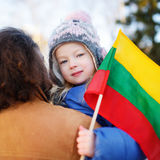 Father and daughter with a flag on Lithuanian independence day Royalty Free Stock Photo