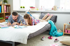 Father and daughter focused on drawing Stock Image