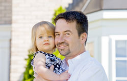 Father and Daughter in Front of House Royalty Free Stock Photos