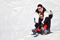 Father and Daughter Fun Sled Ride. ST CERGUE, NYON, SWITZERLAND. Father and daughter enjoying a fun sled ride on Christmas Day. Picture taken on 25th December Royalty Free Stock Photo