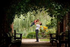 Father and daughter in garden in plant tunnel stock image