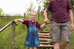 Father and daughter going down the steps Stock Photo