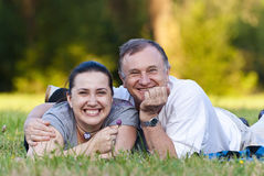 Father and daughter on grass. Happy father and daughter enjoying in the park royalty free stock photo