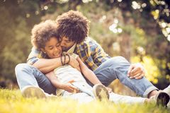Father and daughter on grass. royalty free stock photography