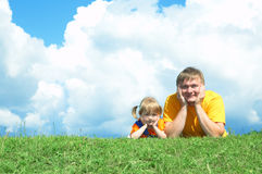 Father with daughter on green grass Stock Photography