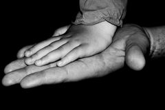 Father and daughter. Hands of father and daughter in black and white Royalty Free Stock Images