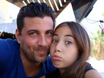 Father and daughter happy faces gorgeous portraits happiness family. Cute girl stock images