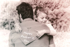 Father and daughter with Happy fathers day. Happy fathers day against photograph of family royalty free stock photography