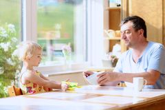Father and daughter having breakfast Royalty Free Stock Image