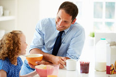 Father And Daughter Having Breakfast In Kitchen Together Royalty Free Stock Images