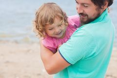 Father and daughter having fun at the beach. Royalty Free Stock Images