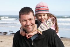 Father And Daughter Having Fun On Beach Together Royalty Free Stock Images