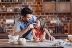 Father and daughter having fun while cooking together royalty free stock images