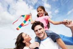 Father And Daughter Having Fun Flying Kite On Beach Holiday Royalty Free Stock Image