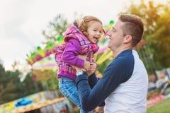 Father and daughter having fun, fun fair, amusement park Stock Image