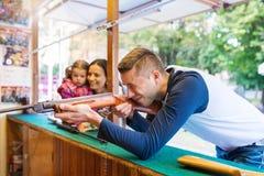 Father and daughter having fun, fun fair, amusement park Stock Photo