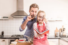 Father and daughter having fun in the kitchen - baking Stock Image