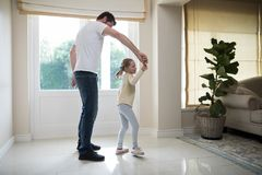 Father and daughter having fun in living room Royalty Free Stock Images
