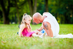 Father and daughter having fun in a park stock photos