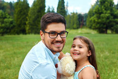 Father And Daughter Having Fun In Park. Family Relaxing Outdoors stock photo