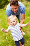 Father And Daughter Having Fun Playing Game Outdoors Royalty Free Stock Photo
