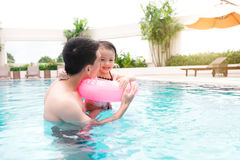Father and daughter having fun in the pool. Summer holidays and Stock Photo