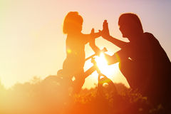 Father and daughter having fun riding bike at Royalty Free Stock Image