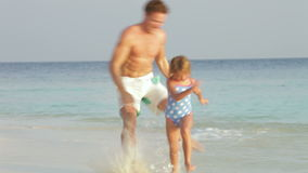 Father And Daughter Having Fun In Sea On Beach Holiday stock video
