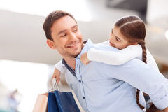 Father and daughter having fun in shopping mall Stock Image