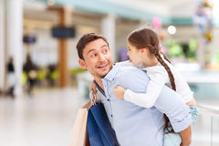 Father and daughter having fun in shopping mall Stock Photo