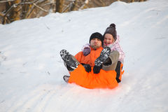 Father and daughter having fun in snow Royalty Free Stock Photo
