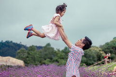 Father and daughter having fun to play together in the garden Royalty Free Stock Image