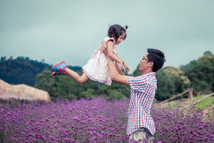 Father and daughter having fun to play together in the garden Stock Images