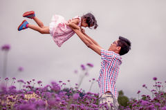 Father and daughter having fun to play together in the garden Royalty Free Stock Photo