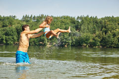 Father and daughter having fun in the water Stock Photos