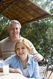 Father and daughter having lemonade royalty free stock images