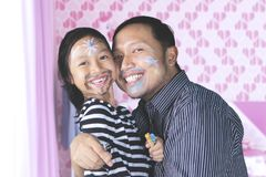 Father and daughter having quality time playing with face painting Stock Images