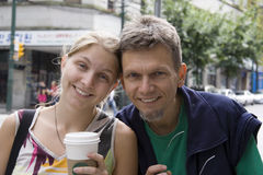 Father and daughter head-to-head. With a smile and a coffee Royalty Free Stock Photos
